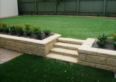 Not only did we lay the synthetic turf for this Toorak Gardens client's backyard, but we also installed retaining walls for them