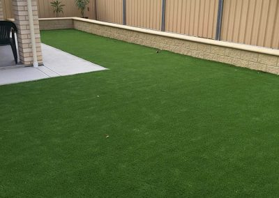 Not only did we lay the synthetic turf for this Enfield client's backyard, but we also installed retaining walls for them