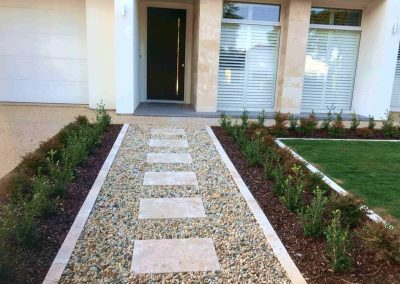 Not only do we specialise in instant and synthetic lawns, we also provide paving services - This suburban Adelaide client opted for a central paving in gravel pathway for their front entrance